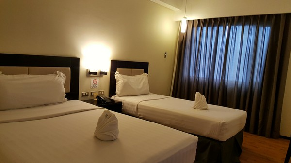 Family Staycation at Mallberry Suites Business Hotel via Traveloka